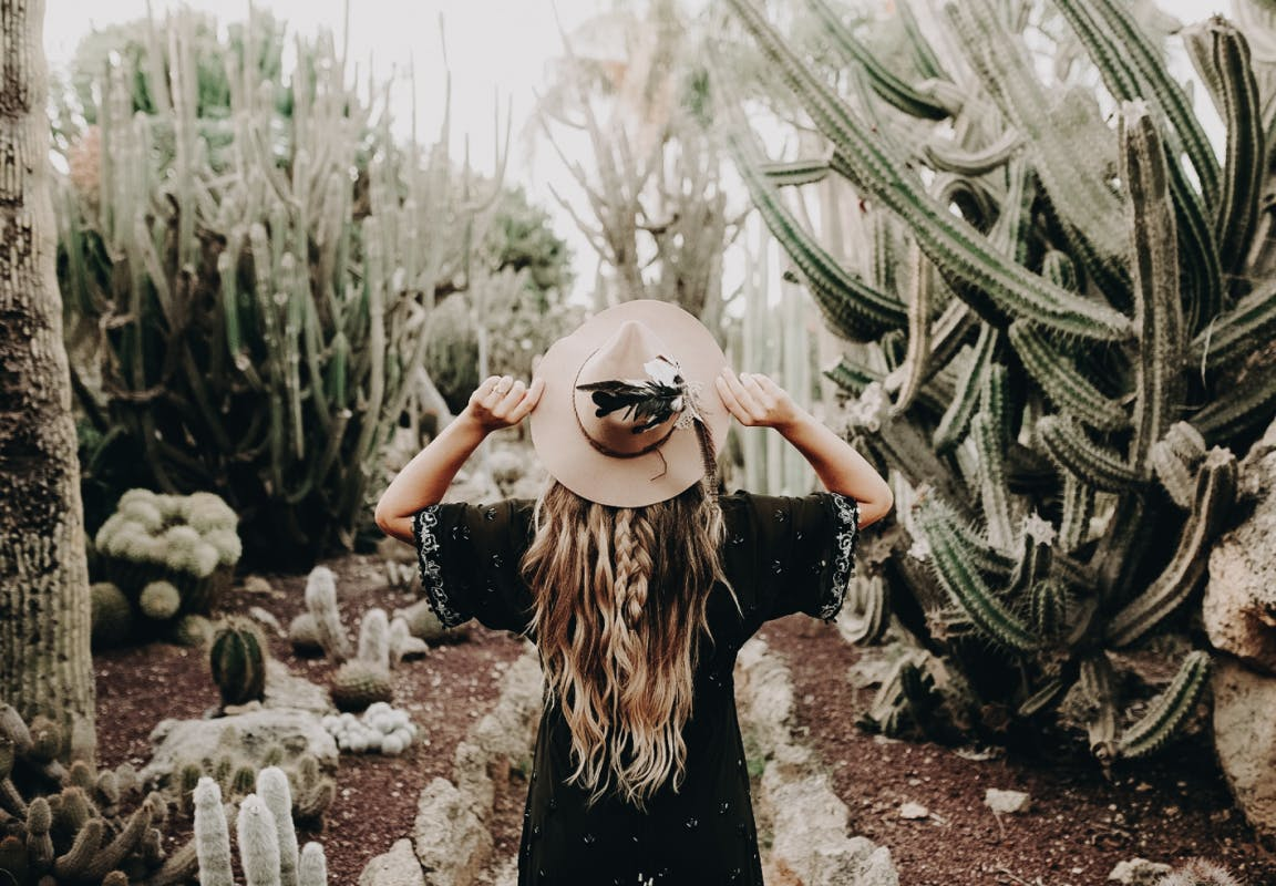 Girl and Cactuses Image